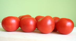 Tomatoes. Some tomatoes with green background stock images