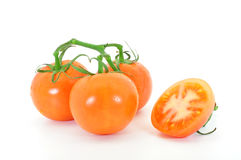 Tomatoes. Truss tomatoes and cut tomato isolated on white Stock Photography