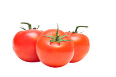 Tomatoes. Three tomatoes isolated on a white background Royalty Free Stock Photography