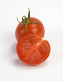 Tomatoes. With one being freshly sliced royalty free stock photos