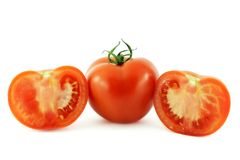 Tomatoes. Whole tomato and two halves Stock Photo