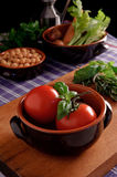 Tomatoes. And basil, traditional italian dish Stock Photography