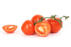Tomatoes. On stem and one juicy slice Royalty Free Stock Photography