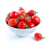 Tomatoes. Red cherry tomatoes in plate on white background Royalty Free Stock Photos