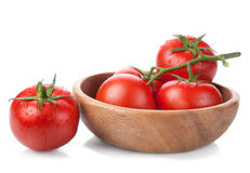 Tomatoes. Brush tomatoes in a wooden bowl isolated on white background Royalty Free Stock Image