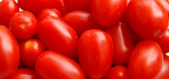 Tomatoes. In close - up- Just the red color and the pattern Stock Photography