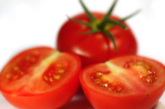 Tomatoes. Whole and cuted tomatoes. White background. Isolated royalty free stock photography