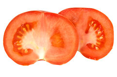 Tomatoes. Sliced red tomatoes isolated on white background Stock Image