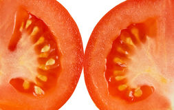 Tomatoes. Sliced red tomatoes isolated on white background Royalty Free Stock Images