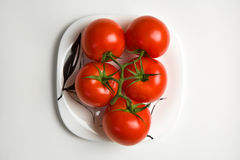 Tomatoes. Juicy tomatoes on a plate Stock Photo