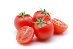 Tomatoes. Close up of red small tomatoes isolated over white Royalty Free Stock Images