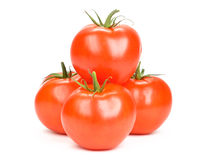 Tomatoes. Four tomatoes isolated on white Stock Photo