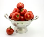 Tomatoes. Isolated colander with tomatoes stock photo