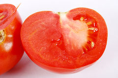 Tomatoes. Two red tomatoes in hand isolated on white Stock Photo