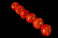 Tomatoes. Vegetables on a black background Stock Photo