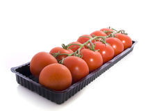 Tomatoes. In a row isolated on a white background Stock Photo