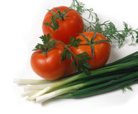 Tomatoes abd garden-stuff isolated on white Stock Photography