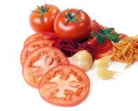 Tomatoes abd garden-stuff isolated on white Royalty Free Stock Photo