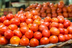Tomatoes. An abundance of ripe tomatoes on a market stall Stock Image