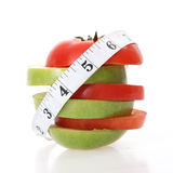 Tomatoes and apple Royalty Free Stock Images