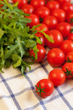 Tomatoes and arugula on towel Royalty Free Stock Images