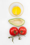 Tomatoes, avocado and olive oil Royalty Free Stock Image