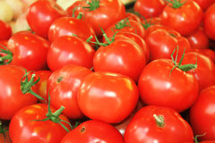 Tomatoes background. Close up of fresh organic tomatos at outdoor market (riga central market Stock Images