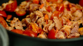 Tomatoes bacon onion carrots in a pan Stock Image