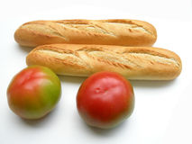 Tomatoes and baguettes Royalty Free Stock Photos