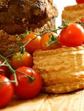Tomatoes and baking on wooden Stock Photography