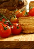 Tomatoes and baking on wooden Stock Photo