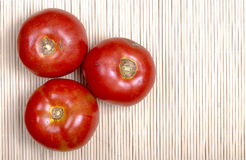 Tomatoes on bamboo mat Royalty Free Stock Photos