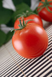 Tomatoes on a bamboo napkin Royalty Free Stock Photos