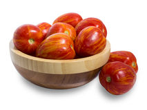 Tomatoes in a bamboo vase. On a white background. Isolated Royalty Free Stock Photos