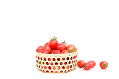 Tomatoes in bamboom handcraft basket. Tomatoes in bamboo handcraft basket isolated in white background Stock Images
