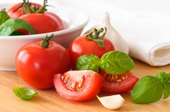 Tomatoes & Basil Royalty Free Stock Images