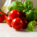 Tomatoes with basil Royalty Free Stock Photo