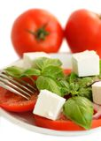 Tomatoes, basil and feta cheese salad Stock Photo