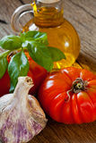 Tomatoes, Basil, Garlic and olive oil Stock Images