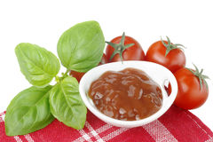 Tomatoes,basil and ketchup Stock Images
