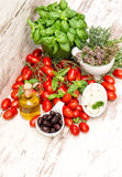 Tomatoes, basil leaves, mozzarella and olive oil Royalty Free Stock Photography