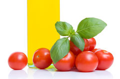 Tomatoes, basil and olive oil Royalty Free Stock Photo