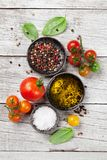 Tomatoes, basil, olive oil and spices Stock Photography