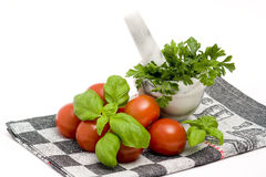 Tomatoes, basil and parsley Stock Images
