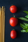 Tomatoes, Basil and pasta. Fresh tomatoes, Basil and pasta royalty free stock image