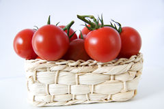 Tomatoes in a basket. Cherry tomatoes in a basket Royalty Free Stock Image
