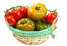 Tomatoes in a basket, isolated on white Stock Photo