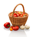 Tomatoes in basket, onion and pepper on stump in garden Stock Images