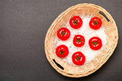 Tomatoes basket Stock Photo