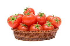 Tomatoes in a basket on a white background Royalty Free Stock Images